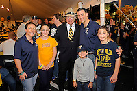 20 December 2011:  FIU President Mark B. Rosenberg poses with tailgaters prior to the game.  The Marshall University Thundering Herd defeated the FIU Golden Panthers, 20-10, to win the Beef 'O'Brady's St. Petersburg Bowl at Tropicana Field in St. Petersburg, Florida.