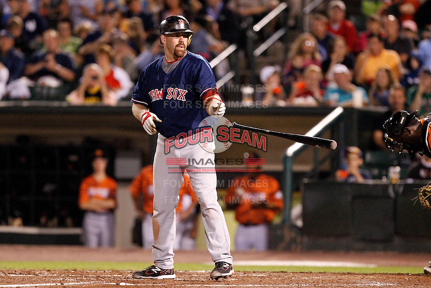 Boston Red Sox outfielder designated hitter Kevin Youkilis #46 tosses his bat after walking in a rehab assignment game with the Pawtucket Red Sox against the Rochester Red Wings  at Frontier Field on August 30, 2011 in Rochester, New York.  Rochester defeated Pawtucket 8-6.  (Mike Janes/Four Seam Images)