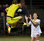 Althoff goalkeeper Ethan Haege (left) leaped to clear the ball away from the gaol late in the first half. At right is Althoff teammate Riley Sullivan who was running in to help. The Althoff High School Crusaders played against the Gibault High School Hawks on Thursday September 27, 2018 at Oerter Park in Columbia. Tim Vizer/Special to STLhighschoolsports.com