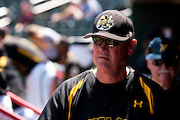 Coach Brent Kemnitz (24) of the Wichita State Shockers stands in the dugout during a game against the Missouri State Bears in the 2012 Missouri Valley Conference Championship Tournament at Hammons Field on May 23, 2012 in Springfield, Missouri. (David Welker/Four Seam Images)