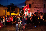 ISTANBUL, TURKEY: Protesters wave a flag depicting Attaturk in the area around Istanbul's Taksim square which has been the focus of recent anti-government protests.<br /> <br /> Protests that began nearly three weeks ago to try and protect an Istanbul park from redevelopment have spread across Turkey and become an expression of wider discontent with the government of Prime Minister Recep Tayyip Erdogan.<br /> <br /> Photo by Kamaran Najm/Metrography