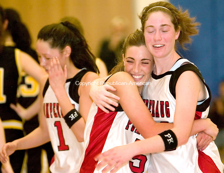 WESTON, CT  24 FEBRUARY 2005 -022406JS06-Pomperaug's Carla Zinno hugs teammate Paige Moore as they celebrate their win over Joel Barlow to take the SWC girls basketball championship Friday at Weston High School.  --- Jim Shannon Republican-American --Weston; Carla Zinno; Paige Moore; Pomperaug; Joel Barlow are CQ