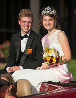 NWA Democrat-Gazette/BEN GOFF @NWABENGOFF<br /> Parker Lee and Kyndall Strickland, Rogers Heritage High homecoming queen, ride in the school's homecoming parade Friday, Oct. 5, 2018, through downtown Rogers. This year's parade had a 'Candyland' theme.