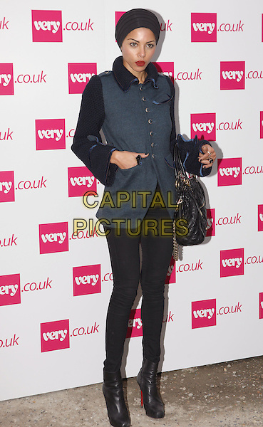 Ana Araujo.The Very.co.uk Fashion Preview for Spring and Summer 2012, Mercer Studios, London, England..September 20th, 2011.LFW full length black blue jacket hat turban bag purse gold buttons hand in pocket boots.CAP/ROS.©Steve Ross/Capital Pictures