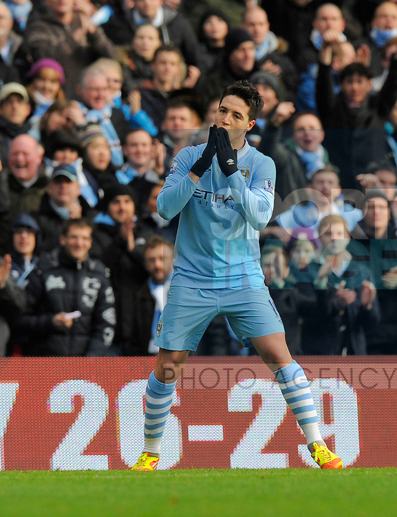 Samir Nasri of Manchester City celebrates scoring the first goal.Barclays Premier League.Manchester City v Tottenham at the Eithad Stadium, Manchester 22nd January, 2012..Sportimage +44 7980659747.picturedesk@sportimage.co.uk.http://www.sportimage.co.uk/.Editorial use only. Maximum 45 images during a match. No video emulation or promotion as 'live'. No use in games, competitions, merchandise, betting or single club/player services. No use with unofficial audio, video, data, fixtures or club/league logos.