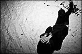 Wroclaw 01.2010 Poland<br /> Drunk transsexual Marina Till lies on the ground.<br /> Marina Till, a transsexual, has had numerous medical examinations and treatments, such as a very intense hormonal therapy, at times seriously weakening her organism. For a long time she has been dreaming  about a sex change surgery that she can not afford. She does not accept herself and her body. Frequent suicide attempts and alcohol abuse, are means of escape from the body she lives in. A body that does not belong to her<br /> Photo: Adam Lach / Napo Images<br /> <br /> Pijany transseksualista Marina Till lezy na ziemi.<br /> Transseksualista Marina Till przeszla juz setki kuracji hormonalnych i badan psychoterapeutycznych, ktore w znaczny sposob wycienczyly jej organizm. Od wielu lat marzy o zmianie plci lecz najzwyczajniej nie stac ja na zbyt kosztowna operacje. Nie akceptuje siebie, nie akceptuje swojego ciala. Czeste proby samobojcze i znaczne ilosci alkoholu sa dla niej sposobem na ucieczke, przede wszystkim od swiadomosci ze cialo w ktorym zyje nie nalezy do niej.<br /> Fot: Adam Lach / Napo Images