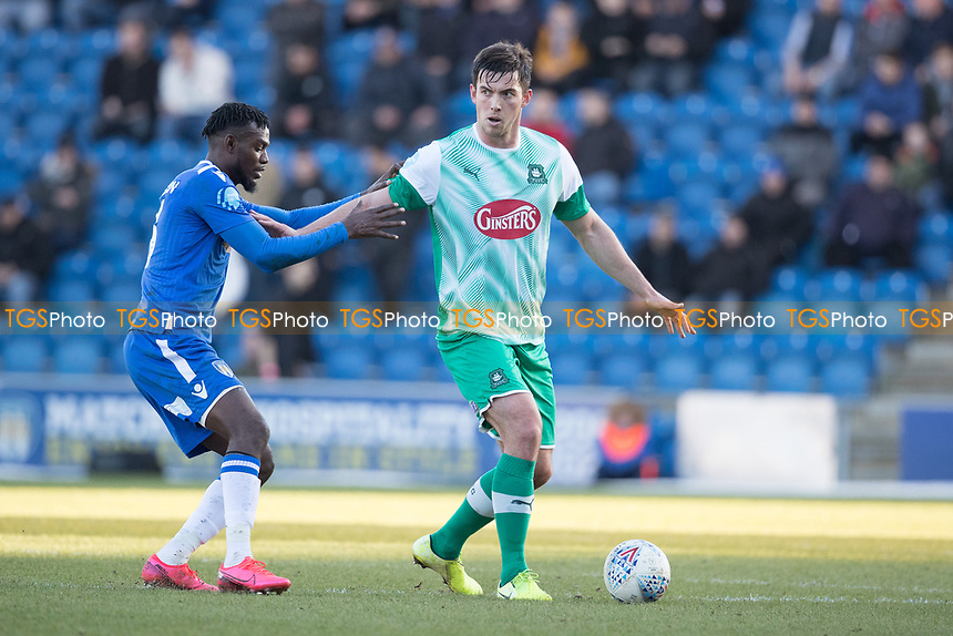 Niall Canavan of Plymouth Argyle holds off Theo Robinson of Colchester United during Colchester United vs Plymouth Argyle, Sky Bet EFL League 2 Football at the JobServe Community Stadium on 8th February 2020