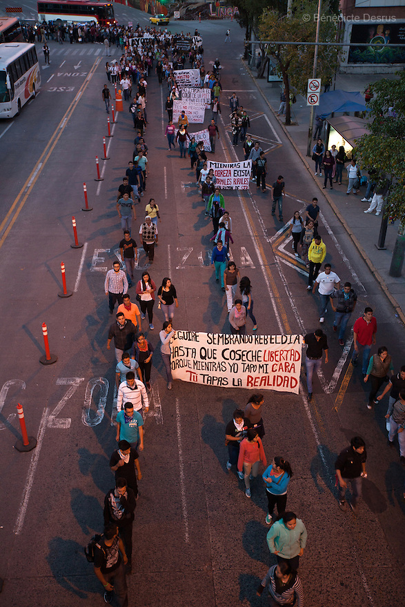 Caravan for Ayotzinapa and demonstrators hold posters and placards during a march in protest for the disappearance of 43 students from Ayotzinapa's teacher training college, in Guadalajara, Jalisco, Mexico on November 18, 2014. The parents and relatives of the 43 missing students still do not believe the official line that the young men are all dead, and with classmates, social organizations and human rights defenders, they started on Thursday a national caravan. They split up into three different caravans, branching out to share information face to face with supporters in other cities and rally nationwide support. The three groups will meet in Mexico City on Thursday 20 for a general strike and massive marches to demand justice and fight against corrupted government and organized crime. Criticism of the government has intensified in Mexico, and many are demanding that the search for the 43 missing students continue until there is concrete evidence to the contrary. (Photo by BénédicteDesrus)