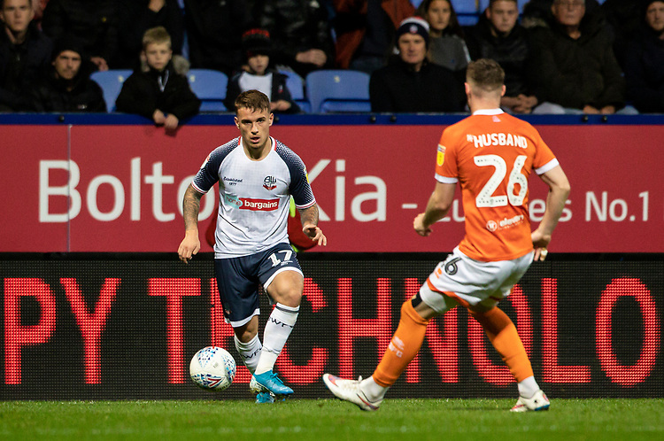 Bolton Wanderers' Thibaud Verlinden competing with Blackpool's James Husband (right) <br /> <br /> Photographer Andrew Kearns/CameraSport<br /> <br /> The EFL Sky Bet League One - Bolton Wanderers v Blackpool - Monday 7th October 2019 - University of Bolton Stadium - Bolton<br /> <br /> World Copyright © 2019 CameraSport. All rights reserved. 43 Linden Ave. Countesthorpe. Leicester. England. LE8 5PG - Tel: +44 (0) 116 277 4147 - admin@camerasport.com - www.camerasport.com