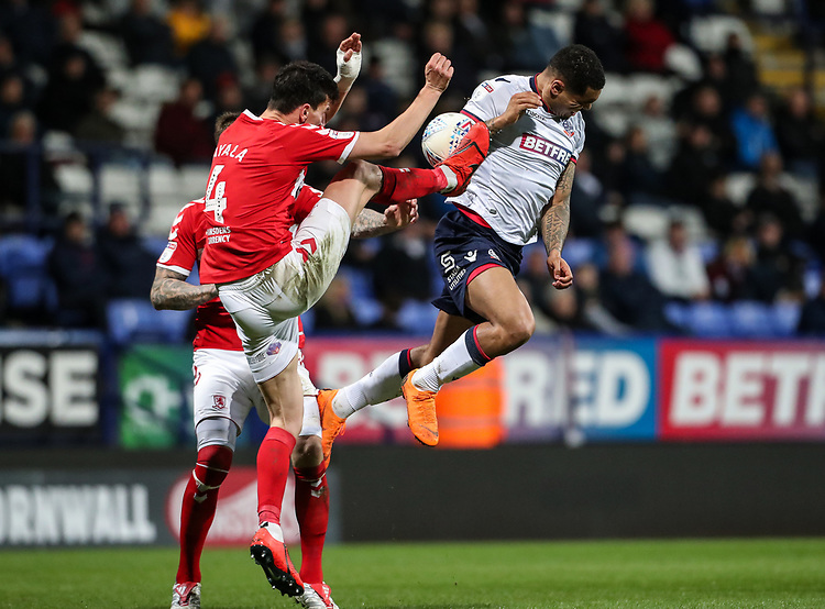 Bolton Wanderers' Josh Magennis competing with Middlesbrough's Daniel Ayala <br /> <br /> Photographer Andrew Kearns/CameraSport<br /> <br /> The EFL Sky Bet Championship - Bolton Wanderers v Middlesbrough -Tuesday 9th April 2019 - University of Bolton Stadium - Bolton<br /> <br /> World Copyright © 2019 CameraSport. All rights reserved. 43 Linden Ave. Countesthorpe. Leicester. England. LE8 5PG - Tel: +44 (0) 116 277 4147 - admin@camerasport.com - www.camerasport.com