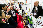 Exhibitors offer samples of their products to visitors a the Chiba Prefecture booth during the 41st International Food and Beverage Exhibition (FOODEX JAPAN 2016) on March 8, 2016, Chiba, Japan. 3,000 exhibitors from 78 nations are showcasing their products in Asia's largest food and beverage trade show held at Makuhari Messe. This year organisers expect 75,000 visitors during the four day show from March 8 to 11. (Photo by Rodrigo Reyes Marin/AFLO)