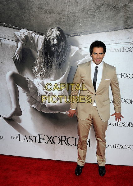 "ELI ROTH .""The Last Exorcism"" Los Angeles Premiere held at Arclight Cinemas, Hollywood, California, USA, .24th August 2010..full length poster beige white shirt tie .CAP/ADM/BP.©Byron Purvis/AdMedia/Capital Pictures."