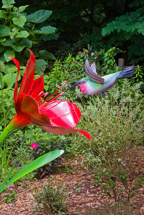 Hummingbird and daylily sculpture, painted steel metal and aluminum by Adrienne Yorinks, artist, and fabricator Dan Kalb garden ornament, oversized large