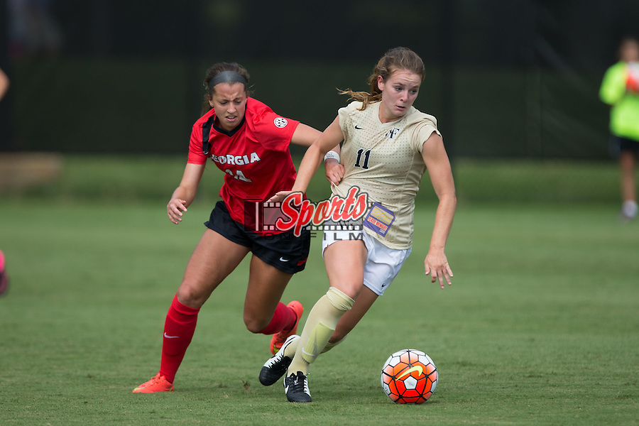 Sydney Shultis (14) of the Georgia Bulldogs grabs the jersey of Maddie Huster (11) of the Wake Forest Demon Deacons to try and keep her from moving the ball up the field at Spry Soccer Stadium on August 23, 2015 in Winston-Salem, North Carolina.  The Deacons defeated the Bulldogs 4-0.   (Brian Westerholt/Sports On Film)