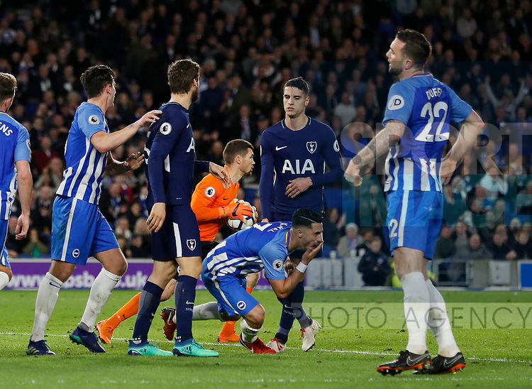 Beram Kayal of Brighton claims Erik Lamela of Tottenham elbows him in the melee during the premier league match at the Amex Stadium, London. Picture date 17th April 2018. Picture credit should read: David Klein/Sportimage