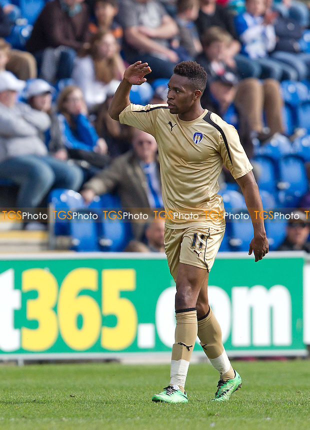 Jean-Louis Akpa Akpro of Tranmere Rovers of Tranmere Rovers (in Colchester away strip) celebrates his opening goal for the visitors - Colchester United v Tranmere Rovers - Sky Bet Championship League Football Division 1 at the Weston Homes Community Stadium, Ipswich, Colchester, Essex  - 05/04/14 - MANDATORY CREDIT: Ray Lawrence/TGSPHOTO - Self billing applies where appropriate - 0845 094 6026 - contact@tgsphoto.co.uk - NO UNPAID USE