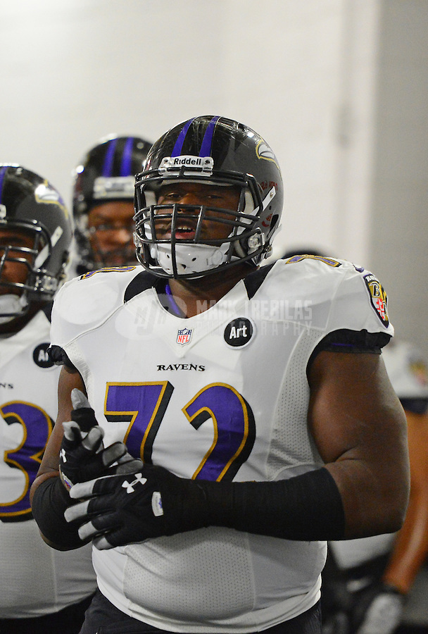 Jan 12, 2013; Denver, CO, USA; Baltimore Ravens guard Kelechi Osemele (72) against the Denver Broncos during the AFC divisional round playoff game at Sports Authority Field.  Mandatory Credit: Mark J. Rebilas-