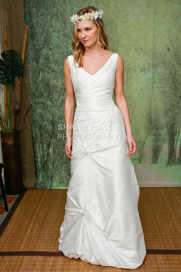 Model wears a Naia wedding dress by Adele Wechsler for the Adele Wechsler Eco Couture Collection VI presentation, during Wedding Channel Show, October 16, 2010.