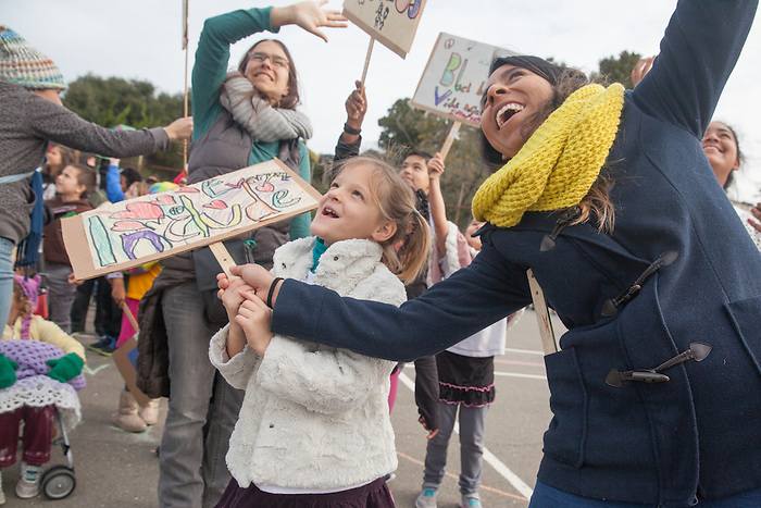 """Melrose Leadership Academy students lead a peace march through Oakland's Maxwell Park Neighborhood on Wednesday, December 7th. The event included an assembly with a video, """"Dear Mr. Trump"""", created by the MLA 8th graders."""