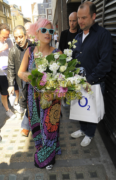 LILY ALLEN .At the O2 Silver Clef Awards Lunch, Hilton Park Lane, London, England, UK, July 4th 2008..full length  blue green pink black print maxi dress bunch of flowers bouquet pink dyed hair turquoise sunglasses ray bans wayfarers .CAP/CAN.©Can Nguyen/Capital Pictures