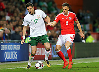 (L-R) James McCarthy of Ireland challenged by Andy King of Wales during the FIFA World Cup Qualifier Group D match between Wales and Republic of Ireland at The Cardiff City Stadium, Wales, UK. Monday 09 October 2017
