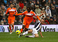 Pictured: Nathan Dyer of Swansea (L) tackled by Nicky Shorey of West Bromwich (R). Saturday, 04 February 2012<br />