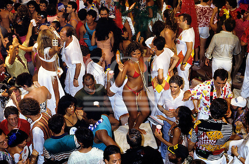 Rio de Janeiro, Brazil. Carnival; people enjoying themselves at La Scala ball; girl dancing on table in bikini with pearls.