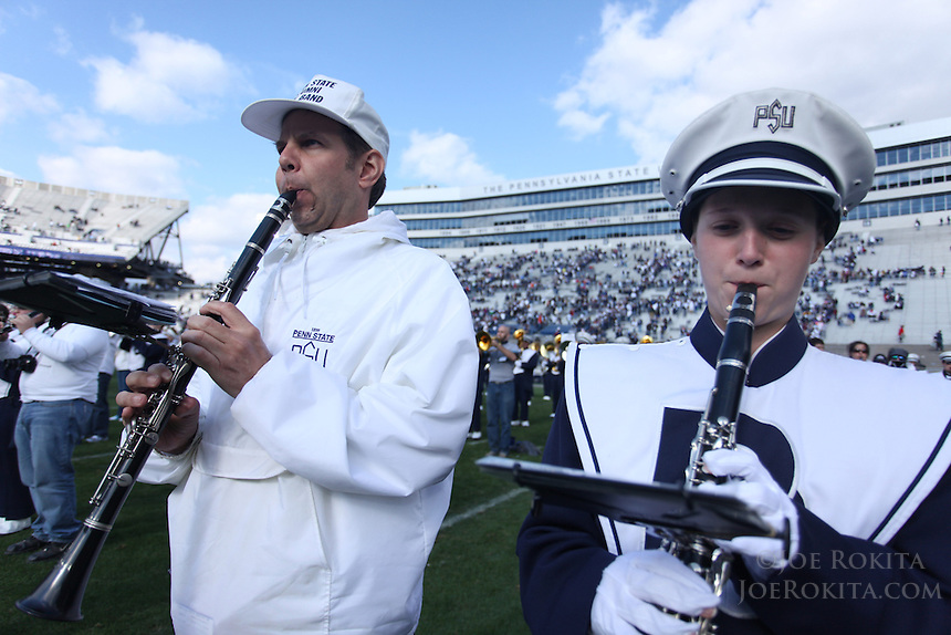 State College, PA - 10/15/2011:  A member of the Alumni Blue Band plays next to a member of the current Blue Band during the post-game concert.  Penn State defeated Purdue by a score of 23-18 on October 15, 2011, homecoming, at Beaver Stadium...Photo:  Joe Rokita / JoeRokita.com..Photo ©2011 Joe Rokita Photography