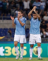Calcio, Serie A: Lazio vs Bologna. Roma, stadio Olimpico, 22 agosto 2015.<br /> Lazio&rsquo;s Stefan De Vrij, left, and Mauricio greet fans at the end of the Italian Serie A football match between Lazio and Bologna at Rome's Olympic stadium, 22 August 2015. Lazio won 2-1.<br /> UPDATE IMAGES PRESS/Isabella Bonotto