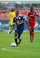 August 21 2010 New York Red Bulls midfielder Tony Tchani #23 in action during a game between the New York Red Bulls and Toronto FC at BMO Field in Toronto..The New York Red Bulls won 4-1