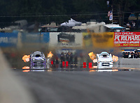 Sep 14, 2018; Mohnton, PA, USA; NHRA funny car driver Jack Beckman (left) races alongside Robert Hight during qualifying for the Dodge Nationals at Maple Grove Raceway. Mandatory Credit: Mark J. Rebilas-USA TODAY Sports