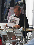 .5-11-09 Exclusive.Michael Keaton eating lunch & reading the New York Times at Cafe Pannini on Main Street in Santa Monica calif. Looking very bald with a broken ankle....AbilityFilms@yahoo.com.805-427-3519.www.AbilityFilms.com.