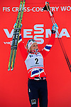 HOLMENKOLLEN, OSLO, NORWAY - March 17: Therese Johaug of Norway (NOR) celebrates her decoration with the Holmenkollen medal (Norwegian skiing's highest award for competitors) at the FIS Cross Country World Cup on March 17, 2013 in Oslo, Norway. (Photo by Dirk Markgraf)..