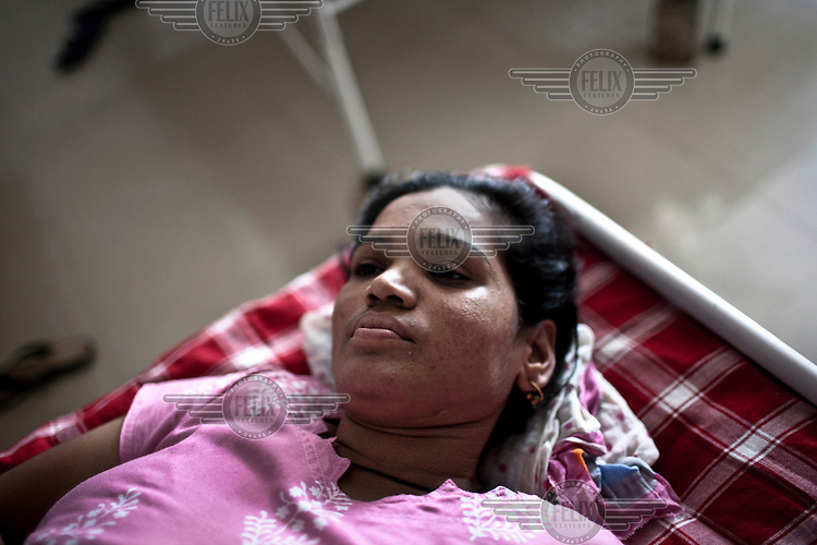 A surrogate mother lies on a bed at the Akanksha Infertility and IVF Clinic. The centre has become the most popular clinic in India for outsourcing pregnancies for western couples.