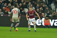 Mark Noble of West Ham United and Sadio Mane of Liverpool during West Ham United vs Liverpool, Premier League Football at The London Stadium on 4th February 2019