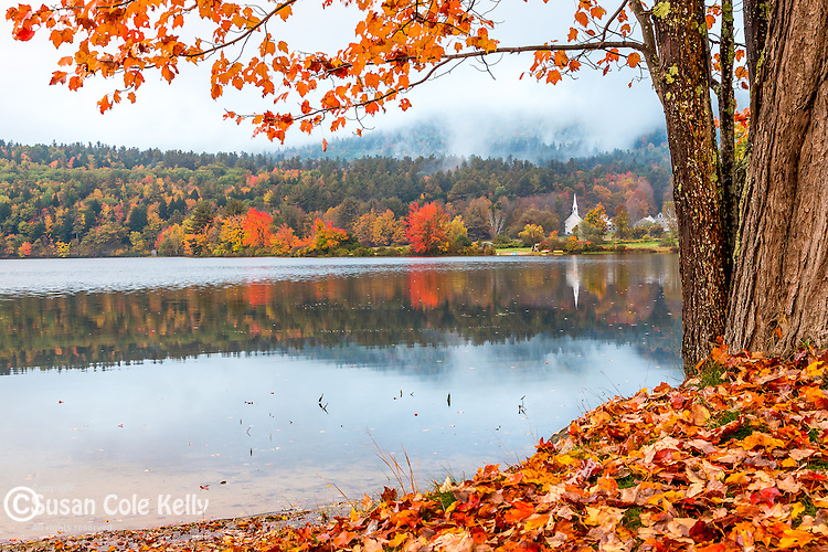 Fall foliage on Crystal Lake in Eaton, New Hampshire, USA