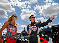 Jul 8, 2017; Joliet, IL, USA; NHRA top fuel driver Leah Pritchett (left) talks with Papa Johns Pizza founder John Schnatter prior to racing head to head in the Charity Challenge race to raise funds and awareness for Infinite Hero Foundation during qualifying for the Route 66 Nationals at Route 66 Raceway. Mandatory Credit: Mark J. Rebilas-USA TODAY Sports
