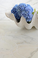 Ursula, a natural stone waterjet and hand cut mosaic shown in Calacatta Tia and Thassos, is part of the Silk Road Collection by Sara Baldwin for New Ravenna Mosaics. Take the next step: prices, samples and design help, http://www.newravenna.com/showrooms/
