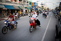 A streetscene from downtoen Pattani. Thailand is struggling to keep up appearances as the land of smiles has to face up to its troubled south. Since 2004 more than 3500 people have been killed and 4000 wounded in a war we never hear about. In the early hours of January 4th 2004 more than 50 armed men stormed a army weapons depot in Narathiwat taking assault rifles, machine guns, rocket launchers, pistols, rocket-propelled grenades and other ammunition. Arsonists simultaneously attacked 20 schools and three police posts elsewhere in Narathiwat. The raid marked the start of the deadliest period of armed conflict in the century-long insurgency. Despite some 30,000 Thai troops being deployed in the region, the shootings, grenade attacks and car bombings happen almost daily, with 90 per cent of those killed being civilians. 19.09.07. Photo: Christopher Olssøn.
