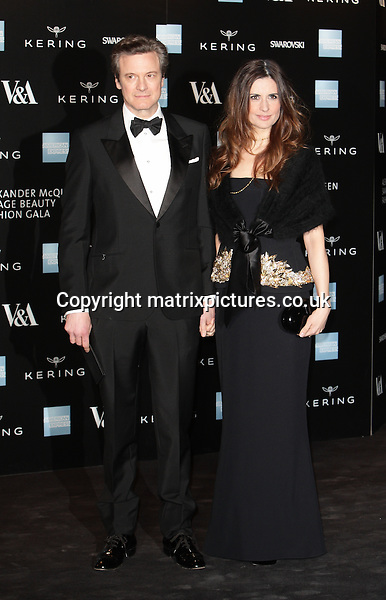 NON EXCLUSIVE PICTURE: MATRIXPICTURES.CO.UK<br /> PLEASE CREDIT ALL USES<br /> <br /> WORLD RIGHTS<br />  <br /> English actor Colin Firth and his wife, Livia Giuggioli attending the Victoria &amp; Albert Museum Fashion Benefit Dinner &amp; Alexander McQueen: Savage Beauty Preview, at the Victoria and Albert Museum in London.<br /> <br /> MARCH 12th 2015<br /> <br /> REF: GBH 15832