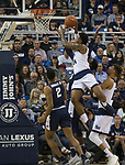 Nevada forward Jordan Caroline (24) takes a shot against Utah State in the second half of an NCAA college basketball game in Reno, Nev., Wednesday, Jan. 2, 2019. (AP Photo/Tom R. Smedes)