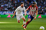 Real Madrid´s Carvajal (L) and Atletico de Madrid´s Filipe Luis during 2015/16 La Liga match between Real Madrid and Atletico de Madrid at Santiago Bernabeu stadium in Madrid, Spain. February 27, 2016. (ALTERPHOTOS/Victor Blanco)
