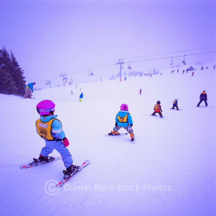 Whistler Ski Resort, BC, British Columbia, Canada - Children learning to downhill ski in Whistler Kids Ski School, on Whistler Mountain