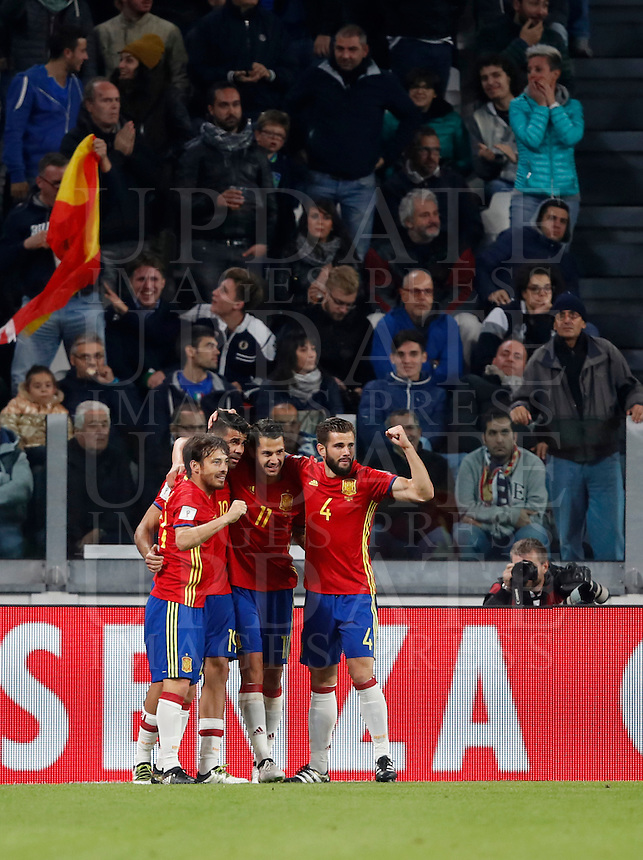 Spain Vitolo, second from left, celebrates with teammates Jordi Alba, left, Diego Costa, second from right, and Nacho, after scoring during the Fifa World Cup 2018 qualification soccer match between Italy and Spain at Turin's Juventus Stadium, October 6, 2016. The game ended 1-1.<br /> UPDATE IMAGES PRESS/Isabella Bonotto