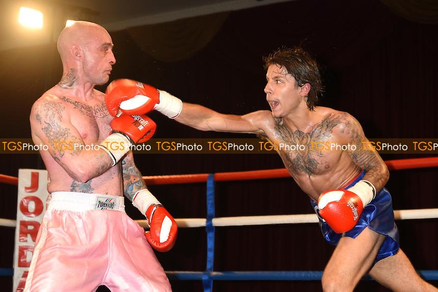 George Hennon (blue shorts) defeats Matt Seawright - Boxing at the Civic Centre, Grays, Essex - 20/06/15 - MANDATORY CREDIT: Philip Sharkey/TGSPHOTO - Self billing applies where appropriate - contact@tgsphoto.co.uk - NO UNPAID USE