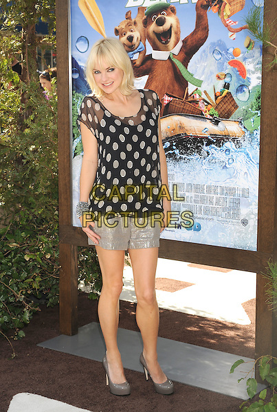 "ANNA FARIS .arriving at the Los Angeles premiere of ""Yogi Bear"" in Westwood Village, California, USA, December 11th, 2010. .full length black and white polka dot sheer top t-shirt gold shorts metallic grey gray platform shoes platform .CAP/ROT/TM.©TM/Roth StockCapital Pictures"