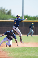 Milwaukee Brewers shortstop Brice Turang (2) leaps over a San Diego Padres baserunner on a double play attempt during an Instructional League game against the San Diego Padres at Peoria Sports Complex on September 21, 2018 in Peoria, Arizona. (Zachary Lucy/Four Seam Images)