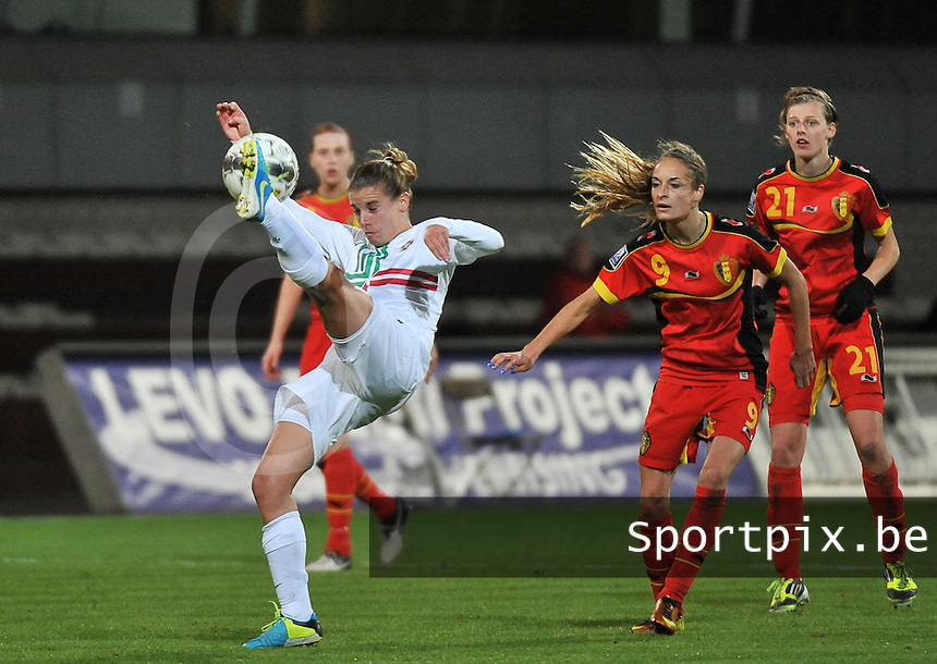 20131031 - ANTWERPEN , BELGIUM : Belgian Tessa Wullaert (9) pictured watching the move of Portugese Pisco (11)  during the female soccer match between Belgium and Portugal , on the fourth matchday in group 5 of the UEFA qualifying round to the FIFA Women World Cup in Canada 2015 at Het Kiel stadium , Antwerp . Thursday 31st October 2013. PHOTO DAVID CATRY