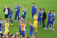 Argentina coach Alejandro Sabella puts his arm around Javier Mascherano as his players show a look of dejection after full time