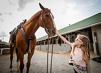 LOUISVILLE, KY - MAY 02: A young racing fan pets a pony during workouts at Churchill Downs on May 2, 2018 in Louisville, Kentucky. (Photo by Alex Evers/Eclipse Sportswire/Getty Images)